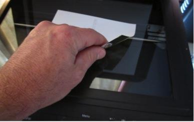 Scanning A scanner is a device that uses a light source and image sensor to digitise flat objects. Some will also scan transparent film such as slides and negatives.