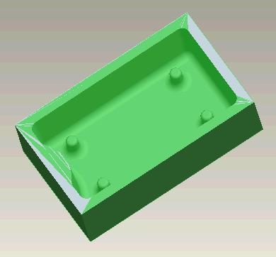defined. To do this choose MFG MODEL CREATE WORKPIECE and type in the name mould_work. Now choose PROTRUSION EXTRUDE SOLID DONE and create a rectangular block of material the same size as the mould.
