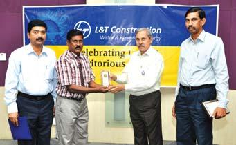 Manager (Stores), L&T-Saudi LLC, receives his award from Mr. J.S. Sudarsan Mr.
