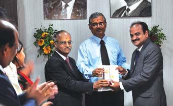 ), UAE-7733-220/33KV SS Project, receives his award from Mr. J.S. Sudarsan Mr.