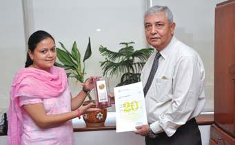 Executive Secretary, DL-R O receives her award from Mr.