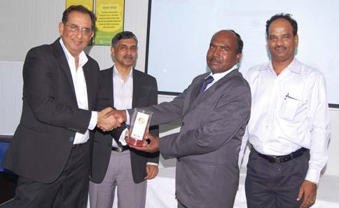 Manager (Administration) (B&F IC), receives his award from Mr.