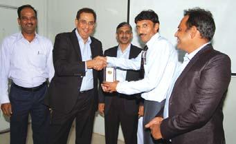 Soman, Construction Manager (Mech.) (B&F IC), receives his award from Mr.