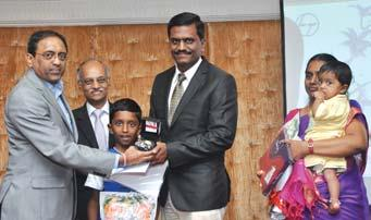 Chennai, receives his award from Mr. S.N. Subrahmanyan in the presence of Mr. S. Rajavel Mr.