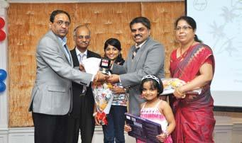 his award from Mr. S.N. Subrahmanyan in the presence of Mr. S. Rajavel Mr.