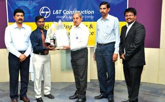 , Junior Foreman (P&M), Nemmeli O/M Site, Chennai receives his award from Mr. N. Ramasethu in the presence of Mr.