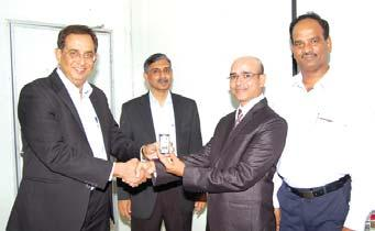 Site receives his award from Mr. D.K. Sen in the presence of Mr. K.V.