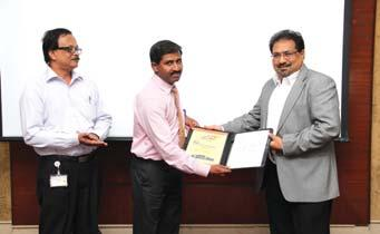 Manager (Civil) Q.C / C.T (B&F IC), receives his award from Mr.