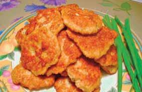 Sizzle canola oil in a frying pan and fry both sides of Chicken Patties over medium heat. Serve Chicken Patties warm.