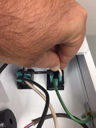 21. Reconnect the BLACK & WHITE wires on the back side of the power socket if you had removed them to determine if you had an issue with the heat platen. 22.