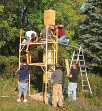 protecting and restoring habitat Photographed from the shore: as the world warms, sea ice breaks / Credit USFWS Boy scouts from Troop 524 and their parents build a chimney swift tower at Aveda