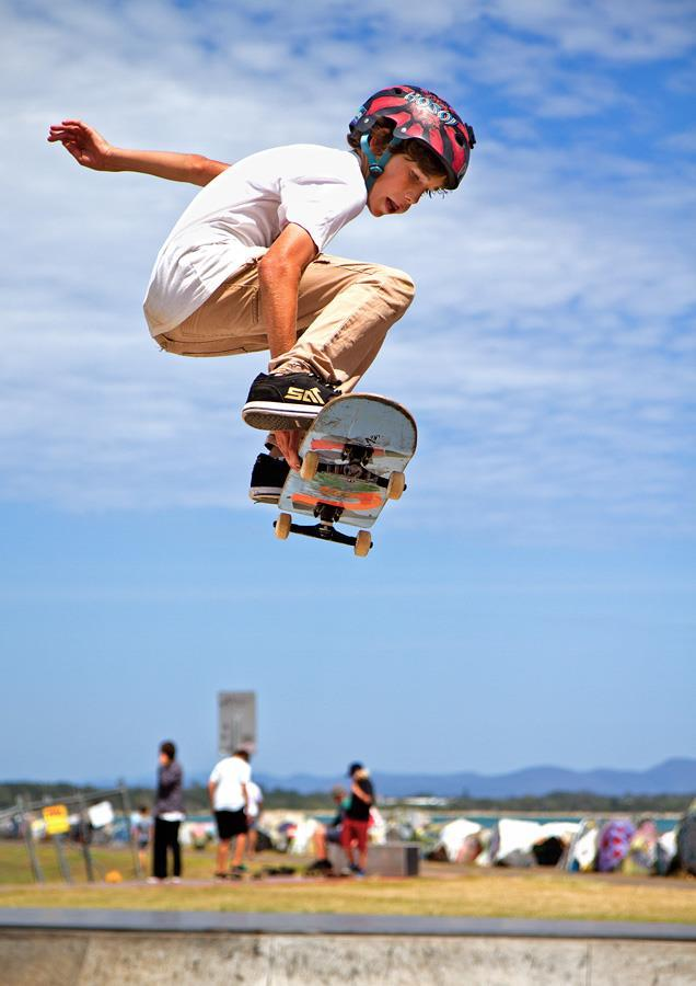 In this image a fast shutter speed (1/1250 th sec) froze the skateboarder in mid air, with little motion