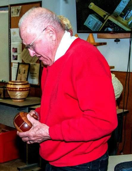 Bruce Tremble with a segmented bowl made of Jakoba, Maple and Walnut.