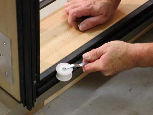 Using the J roller tool provided, roll the rubber gasket securely back into place.