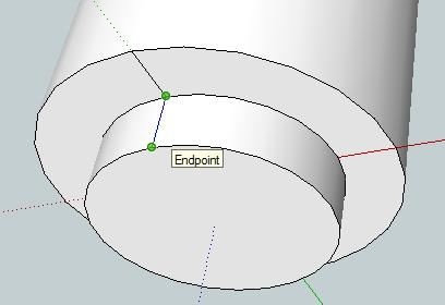Then use the Push/Pull tool to extrude the inner circle by 15 mm (type 15 then
