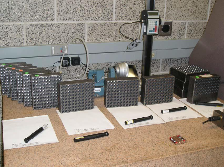 Figure 4: Drilled work pieces. Drilling Procedure 1. Pick a work piece at random from the batch. 2. Turn on the three-axis CNC milling machine. 3. Open safety door. 4. Place billet into manual vice clamp and center.