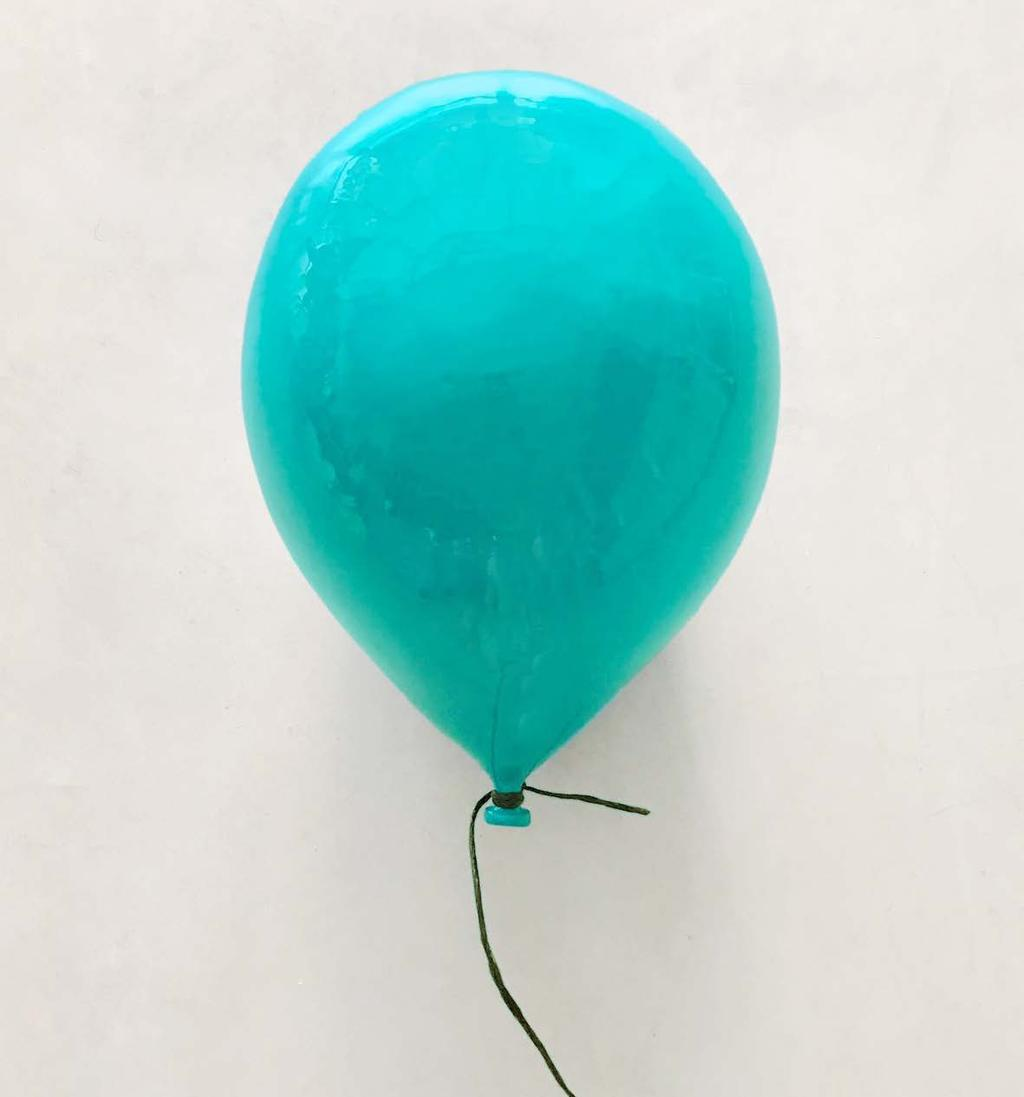 Her balloons in varying sizes, colors and levels of inflatedness hope to trigger positive childhood memories.