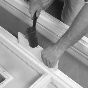 If necessary, use a wood block and rubber mallet to tap mull strip tightly into place (FIGURE 5).