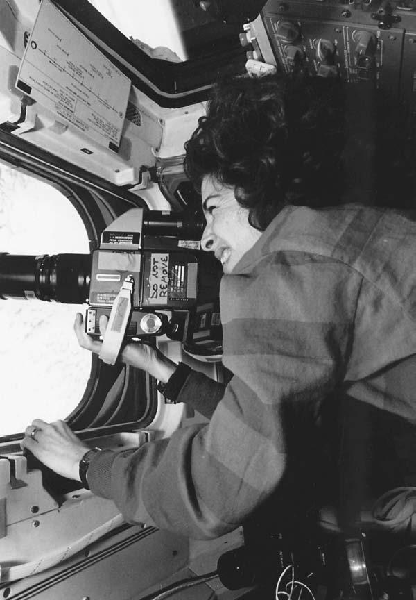 Ellen Ochoa photographing one of Earth s oceans from aboard the Discovery space shuttle during her first mission in 1993.