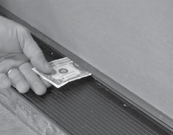 Apply sealant at the outside edge to the flashing to prevent water from getting behind the trim.