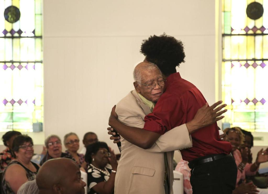 Cameron Johnson hugs his grandfather after singing a